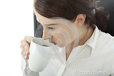 Young brunette business woman drinking coffee