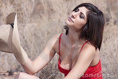 Young brunette cowgirl in the Arizona heat