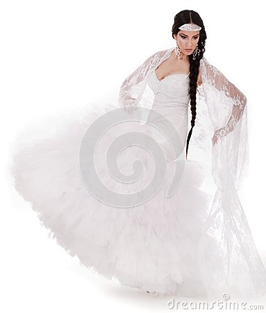 Young brunette dancing bride in white gown