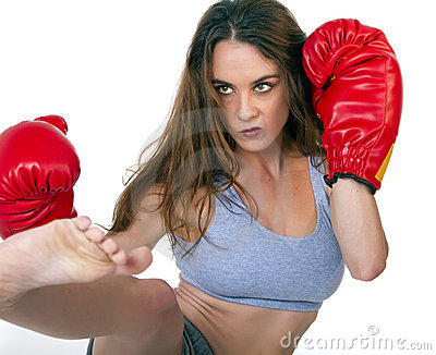 Young brunette female kick boxer