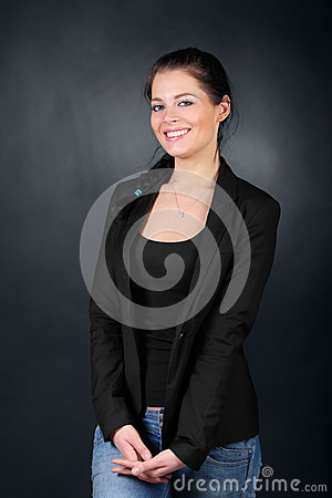 Young brunette girl in coat stand