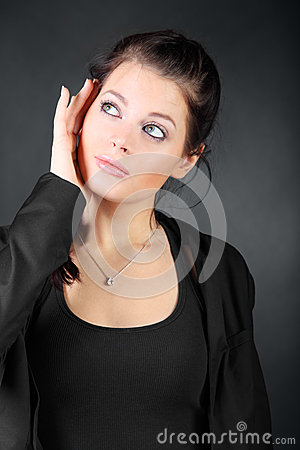 Young brunette girl hold her face