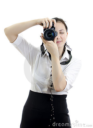 Young brunette girl with photocamera