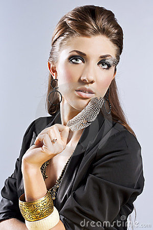Young brunette lady with luxury accessories
