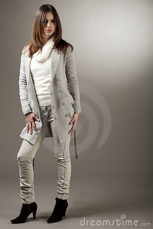 Young brunette model with her spring coat