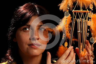 Young brunette and wind chime