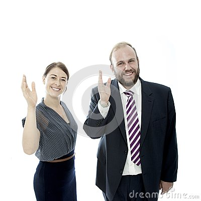 Young brunette woman and beard business man wave
