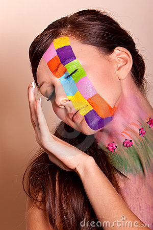 Young brunette woman with colorful makeup