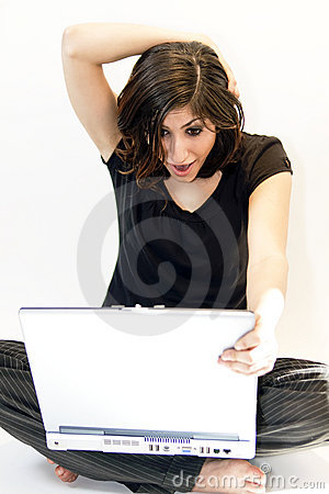 Young Brunette Woman Finds Surprise on Computer