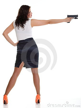 Young brunette woman with gun isolated on white