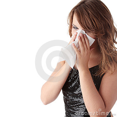 Young brunette woman having a cold