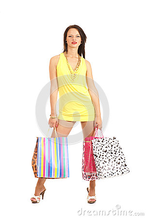 A young brunette woman holding shopping bags
