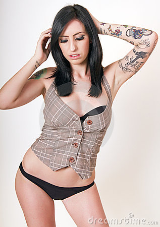 Young brunette woman with tattoos