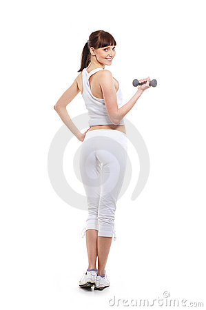 A young brunette woman training with a dumbbell