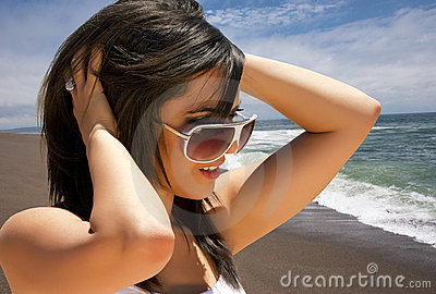 Young brunette woman vacationing on the beach