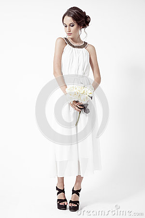 Young brunette woman and white roses. White Background.