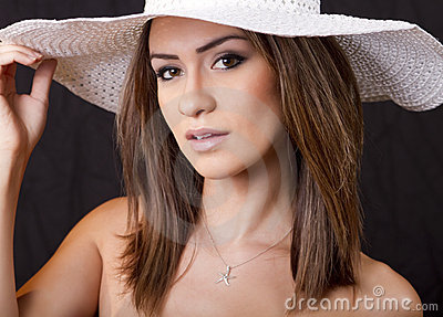 Young  brunette woman with white straw hat