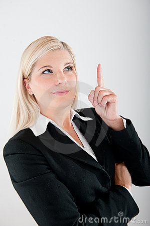 Young busines woman in a suit having an idea