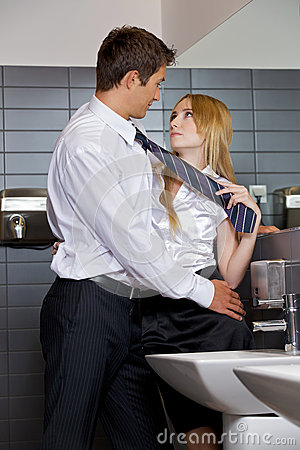 Free Young Business Couple Flirting With Each Other At Office Washroom Royalty Free Stock Image - 53761216