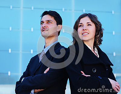 A young business couple standing in formal clothes