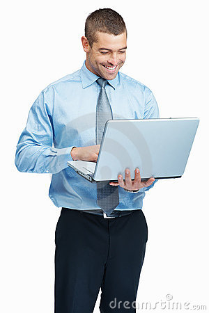 Young business executive working on his laptop