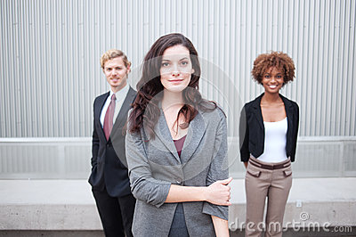 Young business group standing together at office