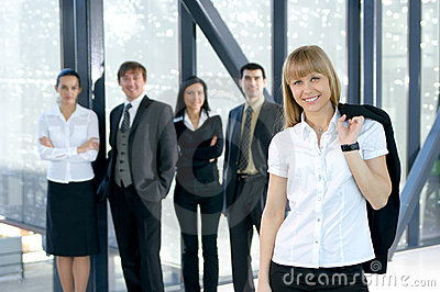 A young business group is working in an office