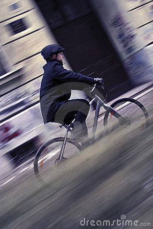 Young business man on a bicycle