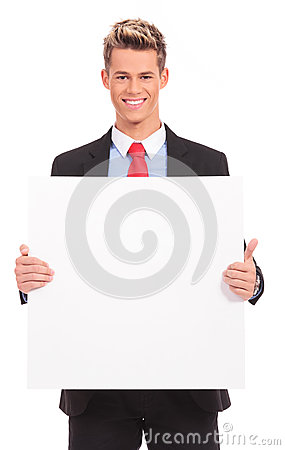 Young business man with blank board