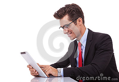 Young business man browsing on his tablet pad