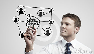 Young business man drawing a social network