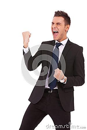 Young business man enjoying success