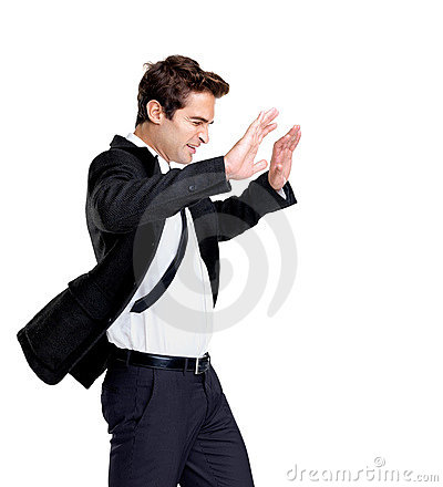 Young business man fighting against wind on white