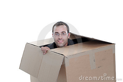 Young business man hiding in a cardboard box