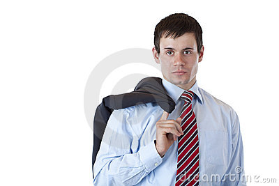 Young business man with jacket looks seriously