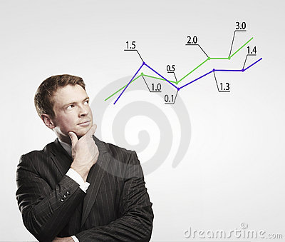 Young business man look at a graph.