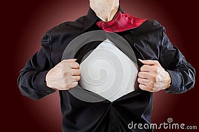 Young business man revealing a superhero suit