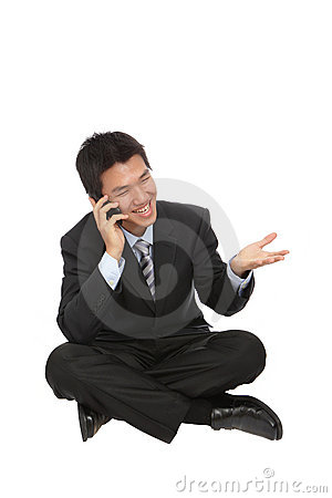 Young business man sit and speaking with phone