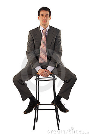 Free Young Business Man Sits On Stool Royalty Free Stock Images - 4852609