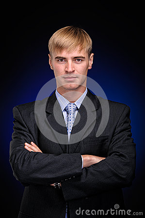 Young business man standing with crossed arms