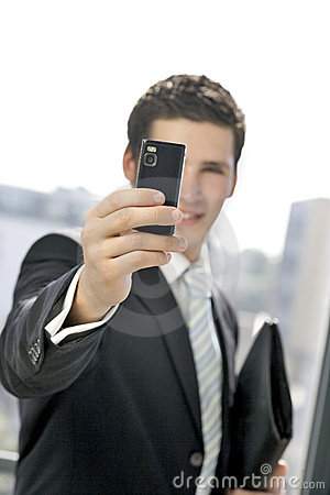 Young business man takes a picture
