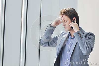 Young business man talk by cellphone