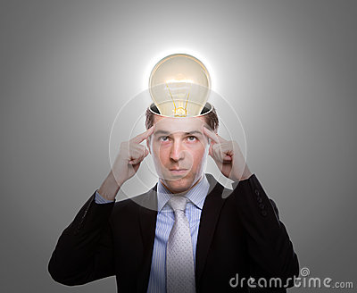 Young business man thinking with light bulb