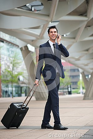 Young business man traveling with bag
