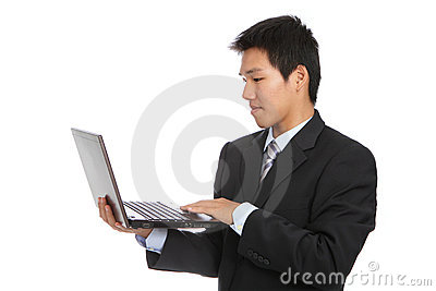 Young business man using notebook