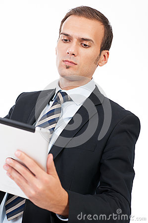 Young business man using a touch screen device