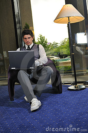 Young business man working on laptop
