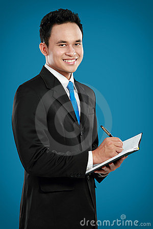 Young Business Man Writing Royalty Free Stock Image - Image: 23968216
