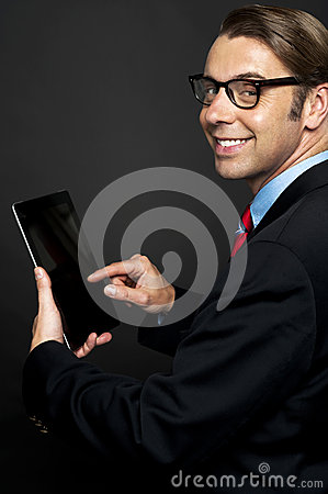 Young business manager working on his tablet pc
