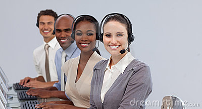 Young business people with headset on smiling